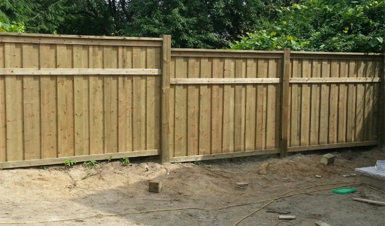 wood fence installation in residential area
